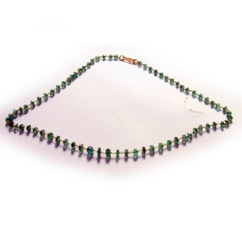 Faceted Emerald and Gold Wire